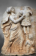 Roman Sebasteion relief  sculpture of a Goddess inscribing a trophy, Aphrodisias Museum, Aphrodisias, Turkey. <br /> <br /> A draped goddess strides forward to inscribe a military trophy to which is bound a kneeling female captive. The goddess is probably a personification such as Honour, Virtue or Courage. .<br /> <br /> If you prefer to buy from our ALAMY STOCK LIBRARY page at https://www.alamy.com/portfolio/paul-williams-funkystock/greco-roman-sculptures.html . Type -    Aphrodisias     - into LOWER SEARCH WITHIN GALLERY box - Refine search by adding a subject, place, background colour, museum etc.<br /> <br /> Visit our ROMAN WORLD PHOTO COLLECTIONS for more photos to download or buy as wall art prints https://funkystock.photoshelter.com/gallery-collection/The-Romans-Art-Artefacts-Antiquities-Historic-Sites-Pictures-Images/C0000r2uLJJo9_s0