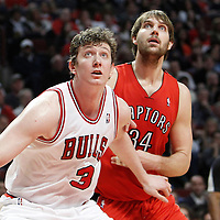 24 March 2012: Toronto Raptors center Aaron Gray (34) vies for the rebound with Chicago Bulls center Omer Asik (3) during the Chicago Bulls 102-101 victory in overtime over the Toronto Raptors at the United Center, Chicago, Illinois, USA.