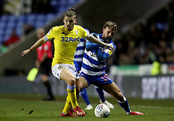 Leeds United's Luke Ayling in action with Reading's John Swift during the Sky Bet Championship match at the Madejski Stadium, Reading.