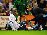 Ashley Young Grimaces in pain after the tackle from Liverpool's Jamie Carragher<br /> Aston Villa 2009/10<br /> Liverpool V Aston Villa (1-3) 24/08/09<br /> The Premier League<br /> Photo Robin Parker Fotosports International