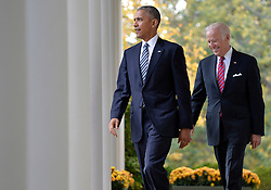 U.S.President Barack Obama (L) walks out of the Oval Office with Vice President Joe Biden to make remarks on Republican President-elect Donald J. Trump's presidential victory over Former Secretary of State Hillary Clinton, at the White House, November 9, 2016, in Washington, DC. Obama invited Trump to visit the White House and promised a smooth transition. ISP Photo by Mike Theiler via UPI