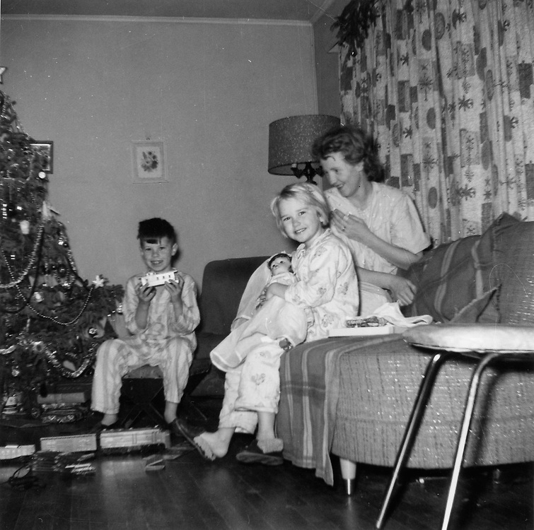 Richard (with Lionel train set), Laura, and mom (Frances).  Christmas in Winnipeg 1960? 61?