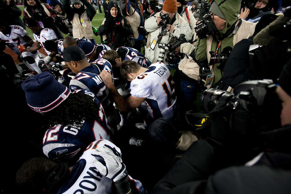 Foxborough, MA 01/14/2012.Quarterback Tim Tebow and the rest of the Denver Broncos kneel in prayer after losing to the Patriots in Saturday's AFC Divisional game..Wicked Local Photo by Alex Jones