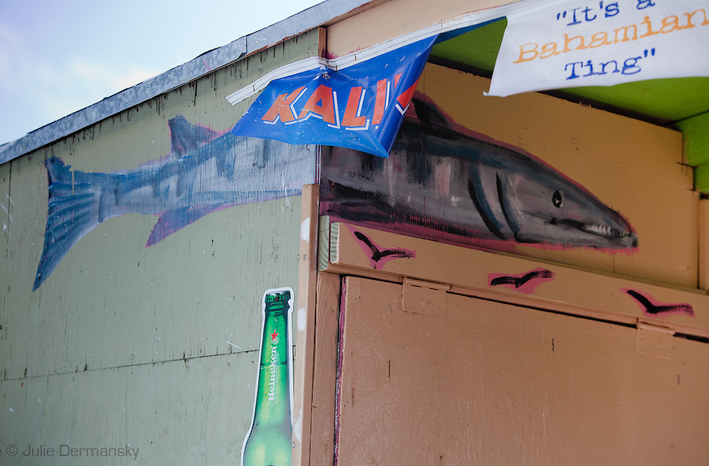 """Hand painted fish on restaurant in Nassau Bahamas in an area known as 'Fishfry"""" were over a dozen casual restaurants popular with locals  for fresh fish and conch. on restaurant in Nassau Bahamas in an area known as 'Fishfry"""" were over a dozen casual restaurants popular with locals  for fresh fish and conch."""