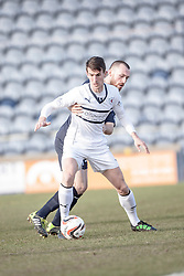 Raith Rovers Grant Anderson and Falkirk's Joe Chalmers.<br /> Half time : Raith Rovers 2 v 1 Falkirk, Scottish Championship game today at Starks Park.<br /> © Michael Schofield.