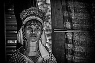 The Long Neck Tribe people are refugees from Myanmar and restrained in Chiang Mai. Others profit from selling them as a tourist attraction. They are on display in this human zoo. Her stoic look tells a compelling story of slavery, exploitation and death of a soul.