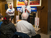 13 JANUARY 2020 - WEST DES MOINES, IOWA: TOM STEYER, right, speaks to a crowd of about 70 people at a house party in West Des Moines Monday night. CHANNING DUTTON, a Des Moines attorney, left, hosted Steyer. The main issue was climate change, which Steyer has said is his top priority. Steyer, a California businessman, is campaigning to be the Democratic nominee for the US Presidency in 2020. Iowa holds the first selection event of the 2020 election cycle. The Iowa Caucuses are Feb. 3, 2020.                PHOTO BY JACK KURTZ
