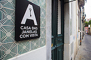 "The sign in the green-tiled facade of hotel ""Casa das Janelas com Vista"", in Bairro Alro district, in Lisbon."