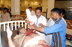 April 27, 2017 - Hyderabad, Sindh, Pakistan - (EDITORS NOTE: Image contains graphic content.) An injured person of a gas cylinder blast having treatment at civil hospital he has lost his both hands and 1 leg due to the blast. (Credit Image: © Janalijanali Laghari Laghari/Pacific Press via ZUMA Wire)