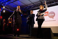 London, UK. 15th January, 2019. Chuka Umunna, Labour MP for Streatham, sharing the stage with Ian Blackford, Leader of the SNP in the House of Commons, and Anna Soubry, Conservative MP for Broxtowe, addresses pro-EU activists attending a People's Vote rally in Parliament Square as MPs vote in the House of Commons on Prime Minister Theresa May's proposed final Brexit withdrawal agreement.