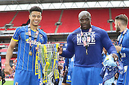 Lyle Taylor and AFC Wimbledon striker Adebayo Akinfenwa (10). AFC Wimbledon promotion to League One, after beating Plymouth Argyle Football Club 2-0 during the Sky Bet League 2 play off final match between AFC Wimbledon and Plymouth Argyle at Wembley Stadium, London, England on 30 May 2016. Photo by Stuart Butcher.