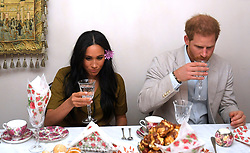 The Duke and Duchess of Sussex take a drink as they visit a family in the Bo Kaap area of Cape Town to mark Heritage Day, a celebration of the great diversity of cultures, beliefs and traditions in South Africa, on day two of their tour of Africa.