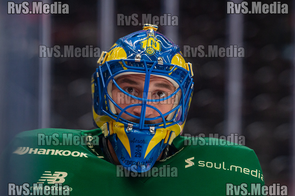 LAUSANNE, SWITZERLAND - SEPTEMBER 24: Goalie Sandro Aeschlimann #29 of HC Davos warms up prior the Swiss National League game between Lausanne HC and HC Davos at Vaudoise Arena on September 24, 2021 in Lausanne, Switzerland. (Photo by Monika Majer/RvS.Media)