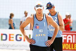 20140606 ITA: EK Beachvolleybal, Cagliari<br /> Alexander Brouwer, Robert Meeuwsen liggen uit het toernooi na hun verlies <br /> ©2014-FotoHoogendoorn.nl / Pim Waslander