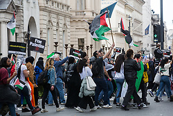 London, UK. 22nd May, 2021. Tens of thousands of people take part in the National Demonstration for Palestine from Victoria Embankment to Hyde Park. The demonstration was organised by pro-Palestinian solidarity groups in protest against Israel's recent attacks on Gaza, its incursions at the Al-Aqsa mosque and its attempts to forcibly displace Palestinian families from the Sheikh Jarrah neighbourhood of East Jerusalem.
