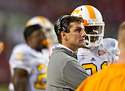 Nov 12, 2011; Fayetteville, AR, USA; Tennessee Volunteers head coach Derek Dooley stands on the sidelines during a game against the Arkansas Razorbacks at Donald W. Reynolds Razorback Stadium. Arkansas defeated Tennessee 49-7. Mandatory Credit: Beth Hall-US PRESSWIRE