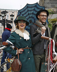 October 8, 2016 - Kiev, Ukraine - Participants pose for a photo as they attend ''Tweed run'' or '''Retro Cruise'' on the St. Sophia Square in Kiev, Ukraine,on 08 October 2016. The participants are dressed in tweed jackets,wool golf socks and trousers, based on the British model,and ride on vintage bikes. (Credit Image: © Serg Glovny via ZUMA Wire)