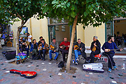A band plays in the street for money Photographed in Athens, Greece