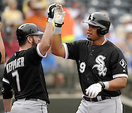 SURPRISE, AZ - MARCH 06:  Jose Abreu #79 of the Chicago White Sox is greeted by Jeff Keppinger #7 after hitting a two-run home run, his first as a member of the Chicago White Sox,  against the Kansas City Royals on March 6, 2014 at The Ballpark in Surprise in Surprise, Arizona. (Photo by Ron Vesely)   Subject: Jose Abreu;  Jeff Keppinger
