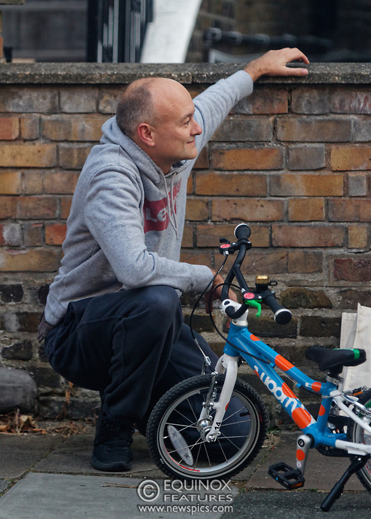 PICTURE EXCLUSIVE - SPECIAL FEES APPLY - CALL BEFORE USE<br /> London, United Kingdom - 8 September 2019<br /> Dominic Cummings looks startled to be spotted arriving back at his north London home on Sunday after a day out with his wife, Mary Wakefield, his son and some friends. Despite clutching a new child's bicycle and fussing over his young son, at times he seemed lost in his thoughts as he tried to focus on his family rather than the dramatic and explosive week in Westminster politics. As Boris Johnson's special political advisor, the former campaign director of Vote Leave has this week found himself at the centre of controversy and harsh criticism from MPs over the handling of the sacking of twenty one rebel Conservative MPs.<br /> EXCLUSIVE PICTURES - MANDATORY BYLINE: EQUINOXFEATURES.COM - A charge is made for each use of each picture in each format on each platform in each territory.<br /> (photo by: EQUINOXFEATURES.COM)<br /> Picture Data:<br /> Photographer: Equinox Features<br /> Copyright: ©2019 Equinox Licensing Ltd. +443700 780000<br /> Contact: Equinox Features<br /> Date Taken: 20190908<br /> Time Taken: 18475045<br /> www.newspics.com