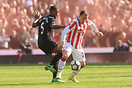 Liverpool's Georgina Wijnaldum battles for the ball with Stoke city's  Xherdan Shaqiri . Premier league match, Stoke City v Liverpool at the Bet365 Stadium in Stoke on Trent, Staffs on Saturday 8th April 2017.<br /> pic by Bradley Collyer, Andrew Orchard sports photography.