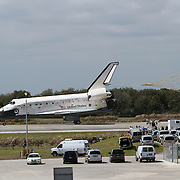 Space Shuttle Discovery returns to the Kennedy Space Center in Cape Canaveral, Florida after completing it's final mission into space on March 9, 2011. (AP Photo/Alex Menendez)