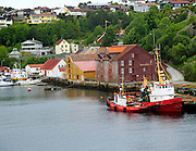 Houses and port quayside of coastal town of Kristiansund, Romsdal county, Norway