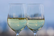 Two glasses of white wine against the sky
