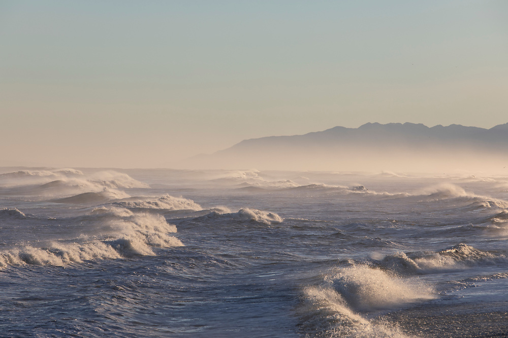 Dramatice ocean views along the West Coast of New Zealand with sun glistening of fthe water