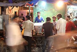 June 25, 2017 - Allahabad, India - Indian people gather near a roadside traditional biriyani shop ,  on the eve of Eid al-Fitr festival , in Allahabad on June 25,2017. (Credit Image: © Ritesh Shukla/NurPhoto via ZUMA Press)