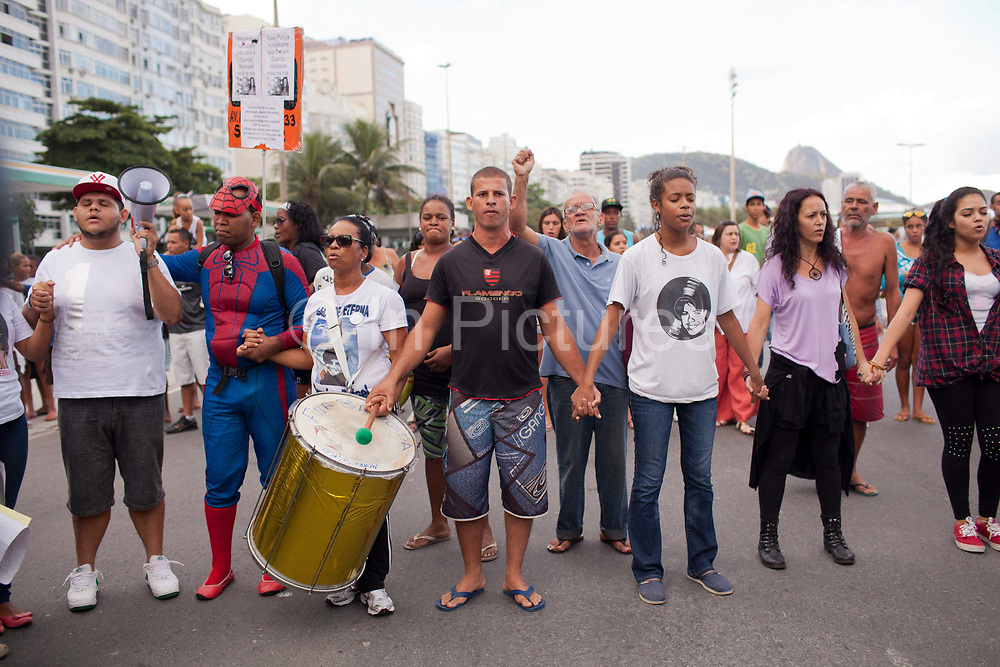 Protest in Copacabana, Rio de Janiero, in response to the mysterious death of professional dancer Douglas Rafael da Silva Pereira, allegedly at the hands of the Police. The favela Pavao-Pavaozinho that sits in between Copacabana and Ipanema. These protests saw a rare solidarity between the mostly middle class black bloc movement and members of the favela community.