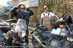 Cool Beans Chris Marino (L) and Biltwell's mechanic and special projects guy Rob Galan of Rouserworks on Motorcycle Sherpa's Ride to the Heavens motorcycle adventure in the Himalayas of Nepal. This first day of riding took us from Kathmandu to Nuwakot. Monday, November 4, 2019. Photography ©2019 Michael Lichter.