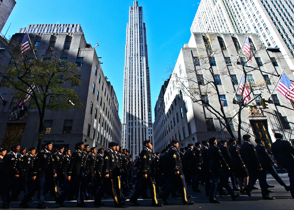Iraq War veteran Sgt. Steven Camilo, of Manhattan, watches the Veteran's Day parade with his son Steven Camilo Jr. 4, make its way up 5th Avenue in Manhattan on Friday, November 11, 2016. (Credit: Byron Smith)