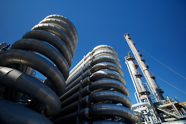 Stock photo of an upward view from between stacks of curved pipes