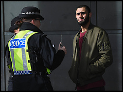 April 17, 2018 - London, London, United Kingdom - Keeping People Safe Campaign. Police officers from the  Metropolitan Police force question a member of the public in Westminster,  as part of a campaign called Keeping People Safe. A joint camping with the British Transport Police, City of London Police, and the Ministry of Defence Police. (Credit Image: © Andrew Parsons/i-Images via ZUMA Press)