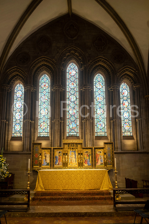 Interior view looking towards the altar in front of stained glass in Hereford Cathedral on 7th June 2021 in Hereford, United Kingdom. Hereford Cathedral is the cathedral church of the Anglican Diocese of Hereford, England. A place of worship has existed on the site of the present building since the 8th century or earlier. The present building was begun in 1079. Substantial parts of the building date from both the Norman and the Gothic periods.