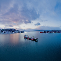Aerial view of the bulk carrier 'Nautical Loredana' at anchor in the port of Narvik in Northern Norway.