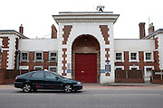 A taxi drives past the main prison gate to YOI Aylesbury.
