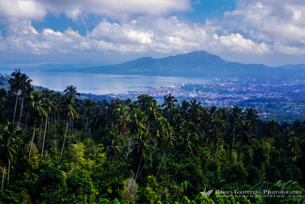 Indonesia, Sulawesi, Manado. View towards Manado city from Tinoor on the road to the Minahasa highlands.