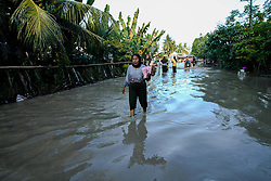 November 17, 2018 - Aceh, Aceh, Indonesia - People wade through the floods caused by heavy rains in North Aceh, on November 17, 2018, Aceh, Indonesia. (Credit Image: © Fachrul Reza/NurPhoto via ZUMA Press)