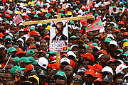 Supporters of the National Union for the Total Independence of Angola (UNITA) hold a José Eduardo dos Santos advertising poster during a demonstration/rally, held at the Independence Square in Luanda at 25 August.