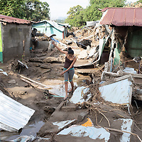 Julia Mejía navigates the rubble where her house was in Chamelecón.<br /> <br /> Hurricanes Eta and Iota hit hard on the north coast of Honduras, leaving some areas flooded for three weeks, destroying people's furniture, belongings, vehicles and houses as well as standing crops.