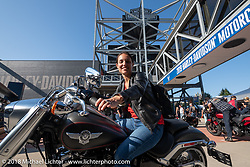 Romina Tropppelli of Buenos Aires, Argentina checks out a brand new 2015 Harley at the Harley-Davidson Museum where the multi-acre campus acted as the central rally point during the Harley-Davidson 115th Anniversary Celebration event. Milwaukee, WI. USA. Thursday August 30, 2018. Photography ©2018 Michael Lichter.