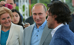 June 24, 2017 - Gurzuf, Crimea, Russia - Russian President Vladimir Putin listens to Director Andrei Kasprzhak, right, as Deputy Prime Minister Olga Golodets, left, looks on during a visit to the Artek Childrens resort June 24, 2017 in Gurzuf, Crimea, Russia. (Credit Image: © Alexei Druzhinin/Planet Pix via ZUMA Wire)