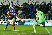 Reading's Alex Pearce climbs over Nottingham Forest's Jamaal Lascelles to get to the ball.<br /> <br /> Photo by James Marsh/CameraSport<br /> <br /> Football - The Football League Sky Bet Championship - Reading v Nottingham Forest - Wednesday 1st january 2014 - Madejski stadium - Reading<br /> <br /> © CameraSport - 43 Linden Ave. Countesthorpe. Leicester. England. LE8 5PG - Tel: +44 (0) 116 277 4147 - admin@camerasport.com - www.camerasport.com
