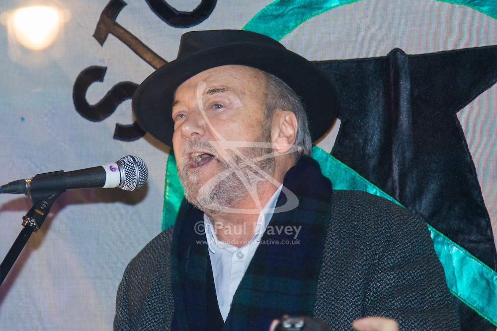 Westminster, London, December 2nd 2015.  As Parliament prepares to vote on air strikes on Islamic State terrorists in Syria, Stop The War and other groups opposed to British military involvement protest outside Parliament. PICTURED: Left wing maverick George Galloway addresses the crowd.///FOR LICENCING CONTACT: paul@pauldaveycreative.co.uk TEL:+44 (0) 7966 016 296 or +44 (0) 20 8969 6875. ©2015 Paul R Davey. All rights reserved.
