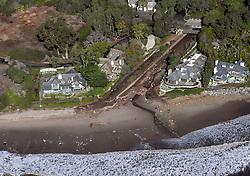 January 10, 2018 - U.S. - Montecito Creek at beach with mudslide debris and person walking on beach. 01/10/18 (Credit Image: © Santa Barbara News-Press via ZUMA Wire)
