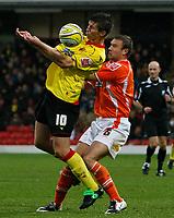 Photo: Richard Lane/Richard Lane Photography. Watford v Blackpool. Coca Cola Championship. 01/11/2008. Grzegorz Rasiak (L) attempts to shield the ball from Ian Evatt (R)
