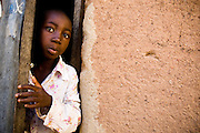 Boy peeking out of a door. Northern Ghana, Thursday November 13, 2008.