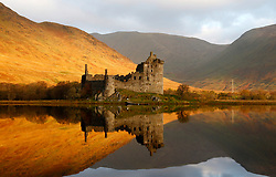 Kilchurn Castle, situated on a rocky peninsula at the northeastern end of Loch Awe was built in the mid-15th century as the base of the Campbells of Glenorchy. Seen here the castle is bathed in the early morning light of an autumnal sunrise... (c) Stephen Lawson   Edinburgh Elite media